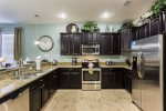 Stainless steel appliances, custom cabinetry, and granite countertops