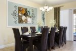 Trendy formal dining area seats ten