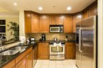 Upgraded kitchen with granite counter tops and stainless steel appliances