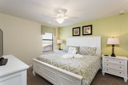Plenty of room for everyone in this inviting bedroom with king bed