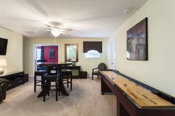 This loft space will be the perfect place to play some shuffleboard and simply have fun