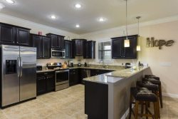 Fully equipped kitchen with upgraded appliances, cabinets, and counters