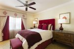 With a mix of warmth and comfortable, this queen bedroom is the perfect place to retire to