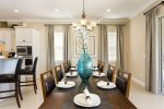 Enjoy home-cooked meals with the family at your dining room table that seats 12