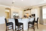 Have guests join you while you cook in bar stool seating