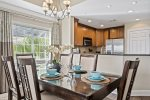 Get together for a delicious meal in the cozy lighting of the dining area