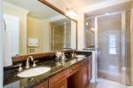 Master ensuite bathroom with upgraded granite and his and her`s sinks