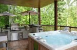 Outdoor Kitchen Grill with Burners and Hot Tub on the Porch