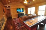 Entertainment Room with Large TV and Indoor Shuffleboard