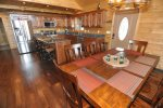Fully Equipped Kitchen Open to Dining Room
