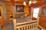 Rustic Timber Queen Bed With TV in the Room