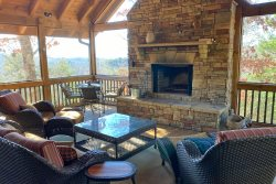 Owls Roost Cabin - Take In the Amazing View from the Inviting Screened Porch with Fireplace - Stylishly Furnished and Convenient to Hiking, Train, and Casino