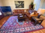 Settle in the Living Room with Fireplace and TV