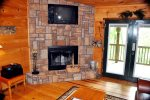 Cozy Up To The Wood Burning Fireplace with TV Above