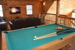 Loft Game Room with a Queen Sleeper Sofa