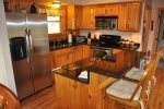 Nicely Equipped Kitchen With Island Bar