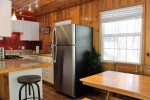 Cute Kitchen with stainless Refrigerator