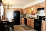 Updated Kitchen with beautiful wood cabinets and Granite Tile Counters