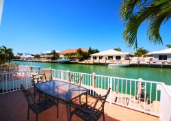 Coral Cove a Beautiful Two-Level Duplex Home w/ Bait Freezer & Dockage