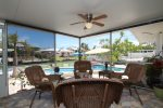 Screened-in Porch Seating Area w/ Canal & Pool Views