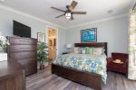 King Master Suite with TV and Balcony Access