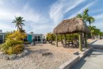 Spacious backyard with outdoor grill, tiki hut and seating