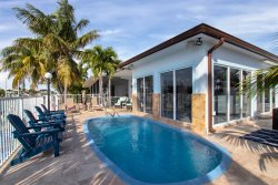 Casa Blanca Canal Front Luxury Vacation Rental w/ Game Room & Pool