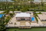 Aerial Shot of the Home with Stunning Golf Course views & Canal Views