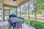 Screened Porch with Grill and Table and Chairs