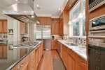 Fully-Equipped Modern Kitchen with Stainless Appliances and Granite Countertops