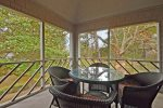 Large screened in porch for relaxing or dining