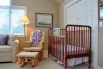 Perfect nursery area with full size crib and rocker