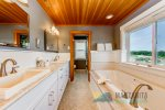 Jetted master bath tub has a wonderful view of mountains and trees.