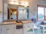 Main level deck with ocean views, great outdoor table and gas BBQ.