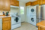Large fridge in the kitchen and washer and dryer for guests use.