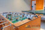 Fun garage with foosball table and ping pong table. There is also beach chairs.