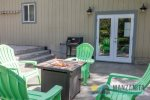 The new backyard patio is a great place to BBQ, sit by the patio or play ping pong in the garage that opens to patio.