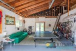 Ping Pong Table in the garage with stereo, seating, etc. Opens to the firepit area.