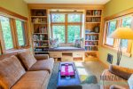 Another view of library, there is a secret passage way from this room that leads to a tiny deck with ocean views.