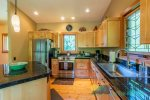 Spacious kitchen with plenty of cabinets, counter space and more.