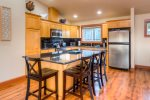 Large kitchen and stainless steel appliances, with a lot of moving around room to prep meals.