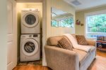 Tucked into the back of the living room is the washer & dryer for guest use.