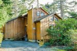 Side entrance into this gorgeous wooden beach cabin that`s only a 4 blocks from the beach and downtown Manzanita.