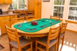 Enjoy a friendly game of poker on the fold out table stored upstairs