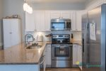 Stainless steel appliances complete the remodeled kitchen