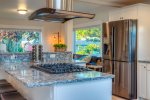Gourmet kitchen with solid granite countertops and high-end appliances.