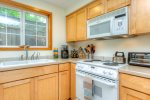 Kitchen equipped with a dishwasher, electric oven/stove top, toaster oven, microwave, crockpot and much more