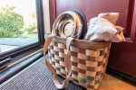 Dog basket with towels and bowl