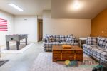 Foosball table, skim boards, beach chairs and beach wagon with toys.