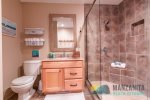 Extra large luxurious shower with 2 showerheads.
